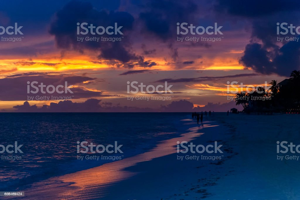 Beautiful blue clouds over sunset on a beach stock photo