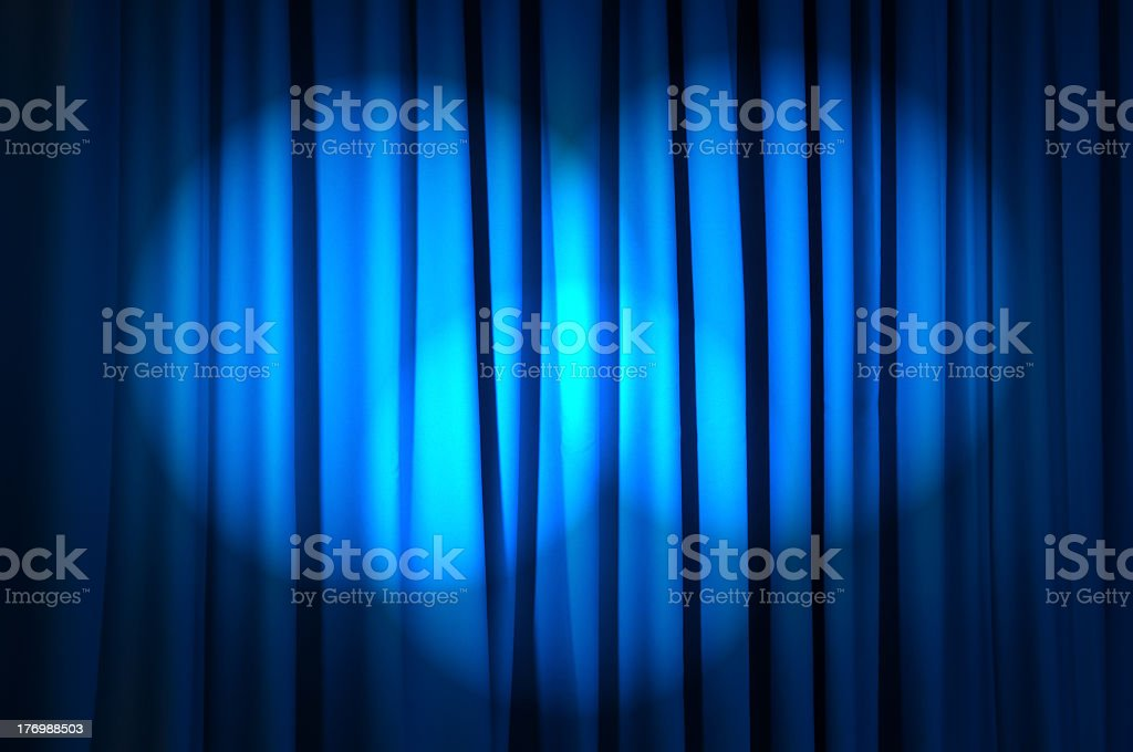 Beautiful blue curtain with spotlights shining on it stock photo
