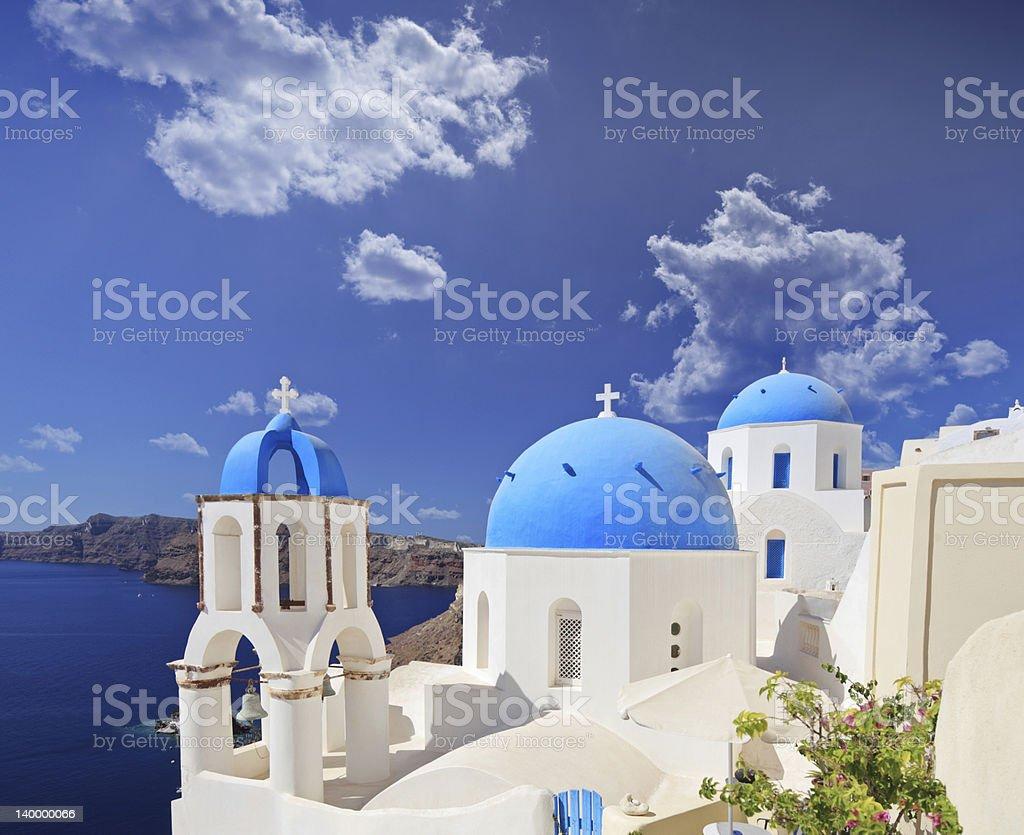 Beautiful blue domed church in Santorini island stock photo