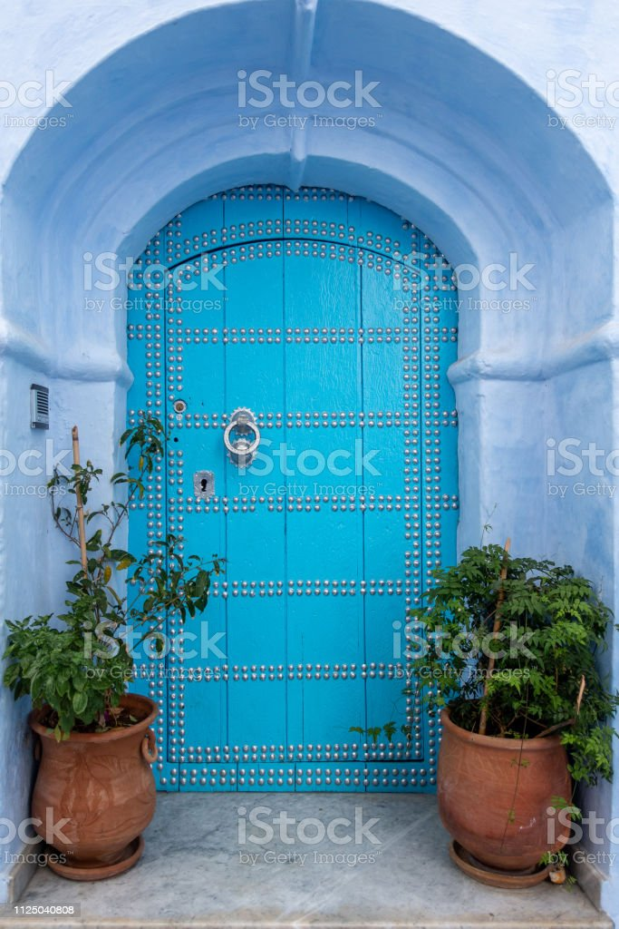 A beautiful blue entrance to a house in Chefchaouen, Morocco stock photo