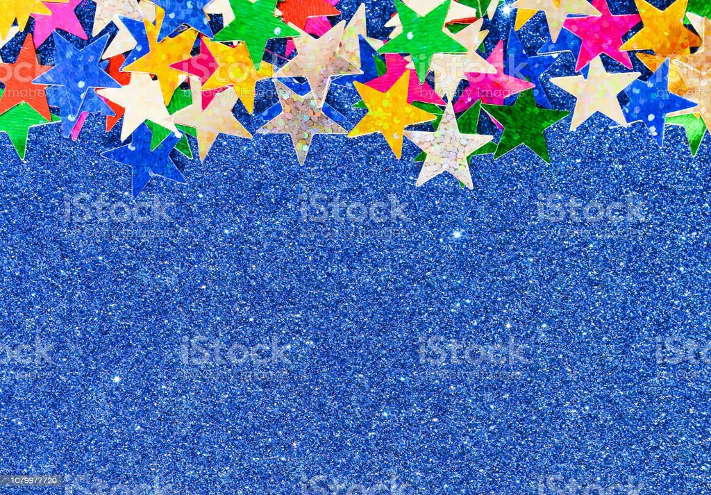 Beautiful blue festive background. Shiny with stars abstract for...