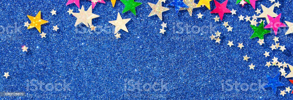 Beautiful blue holiday background. Shiny with stars abstract for...
