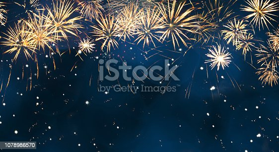 977840698 istock photo Beautiful Blue Holiday background with fireworks 1078986570