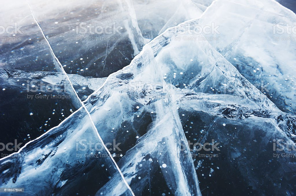 Beautiful blue ice on the winter lake. stock photo