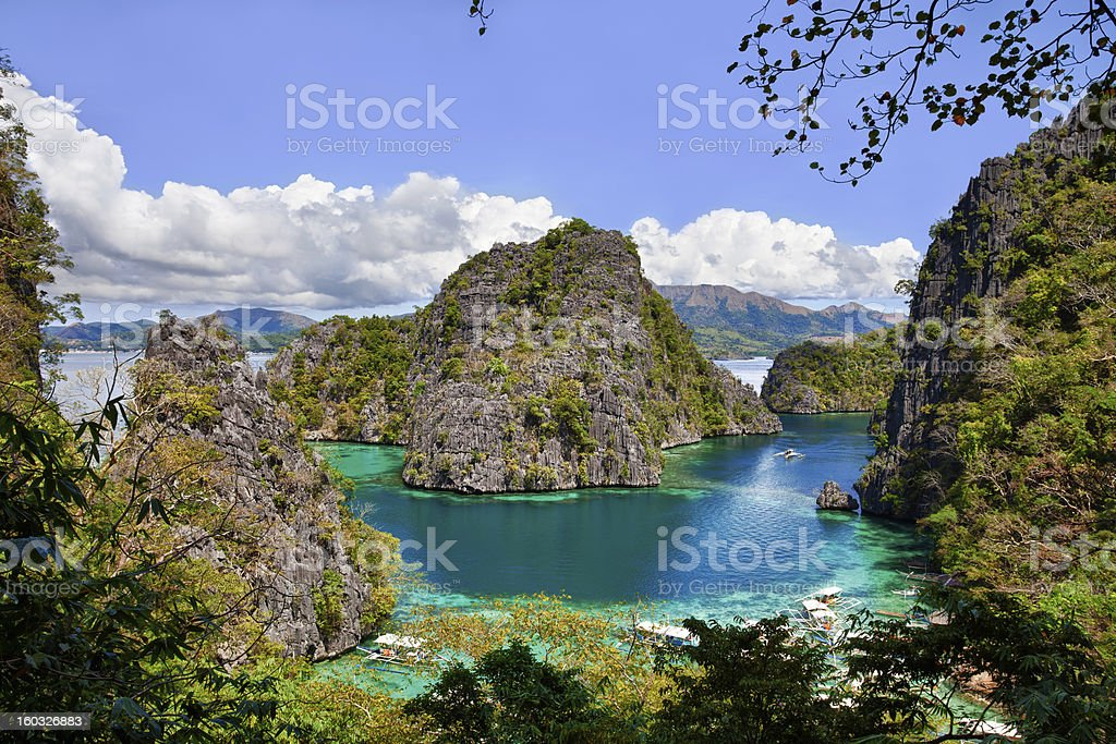 Beautiful Blue Lagoon at Kayangan Lake in the Philippines stock photo