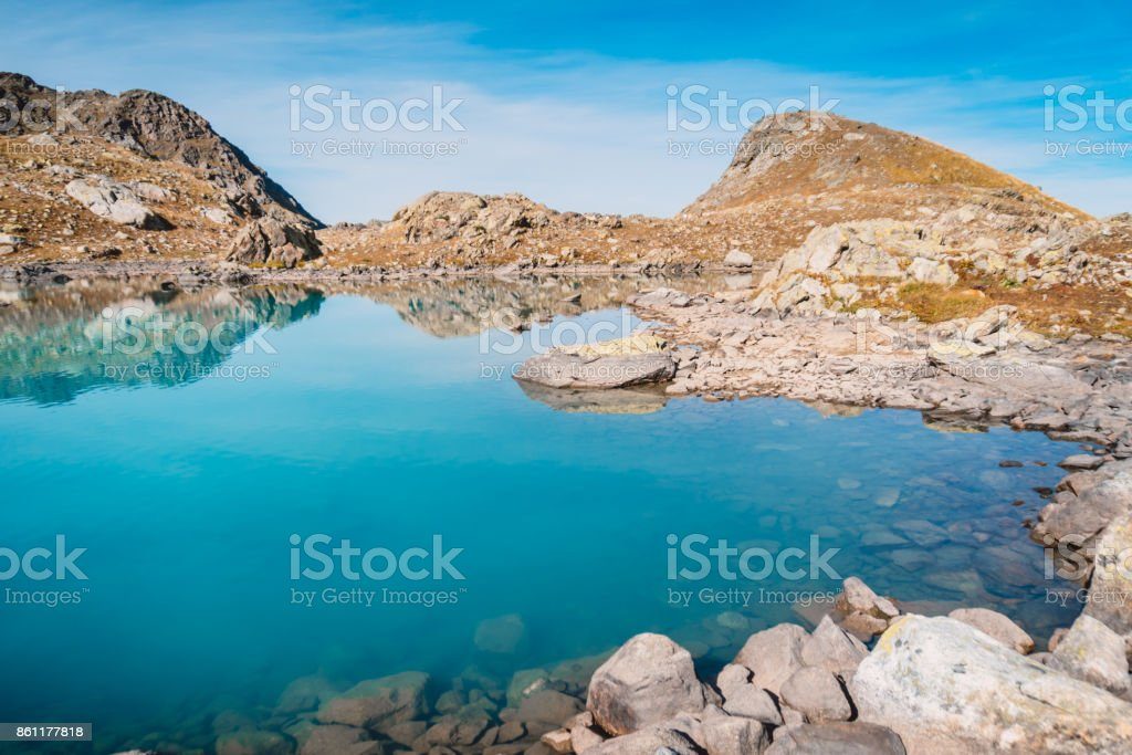 Beautiful blue mountain lake and stones. High in the mountains stock photo