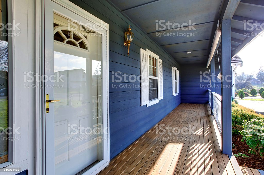 looking out front door. Beautiful Blue Porch Looking Out Into Front Yard. Royalty-free Stock Photo Door