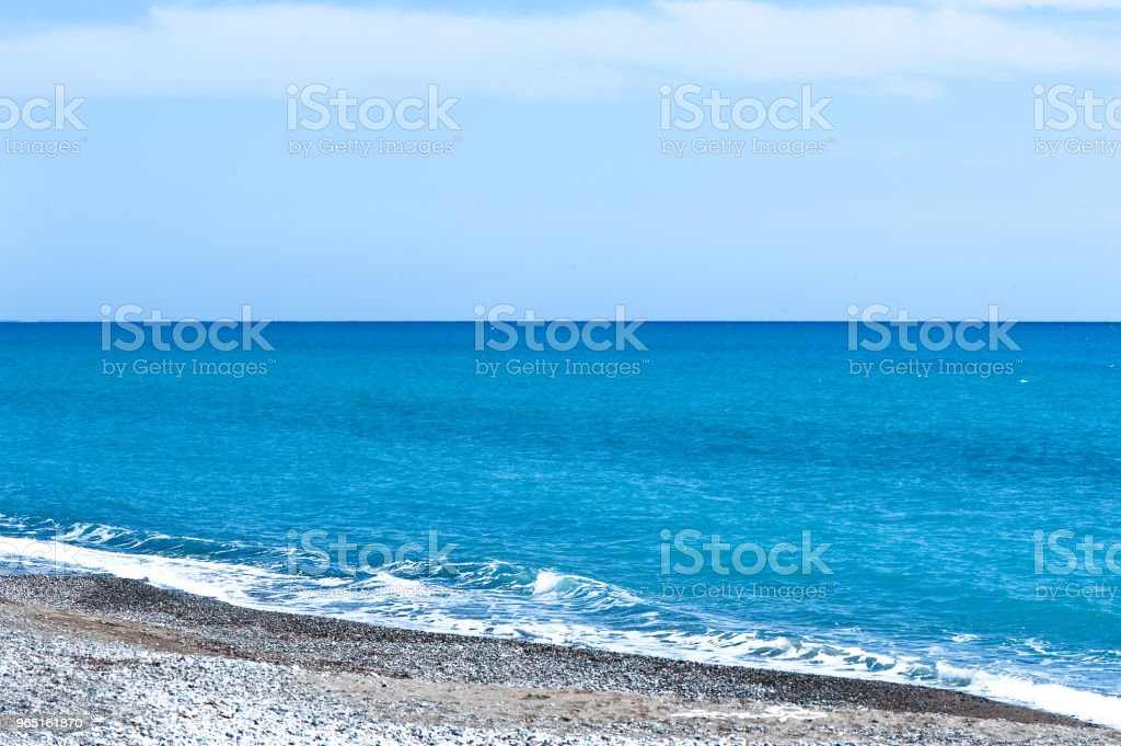 Beautiful blue sea and stony shore zbiór zdjęć royalty-free