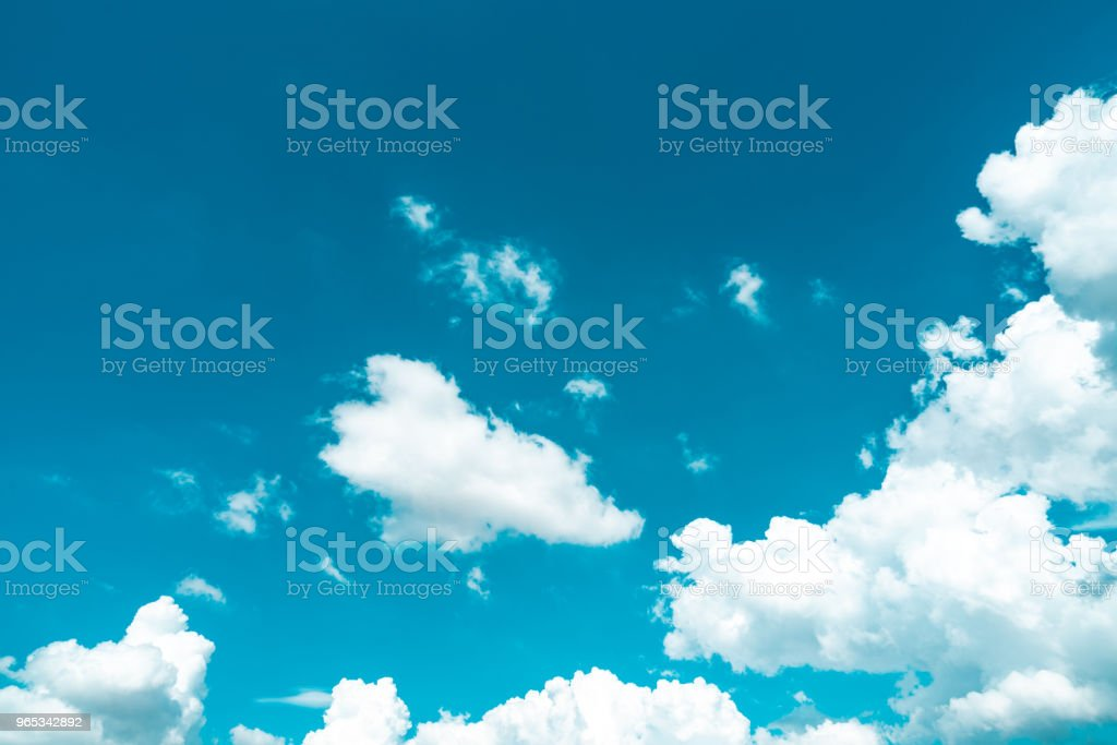 Beautiful blue sky and white cumulus clouds background. Background for peace, summer, bright day. Use for happy mood, fun and vacation day on summer background royalty-free stock photo