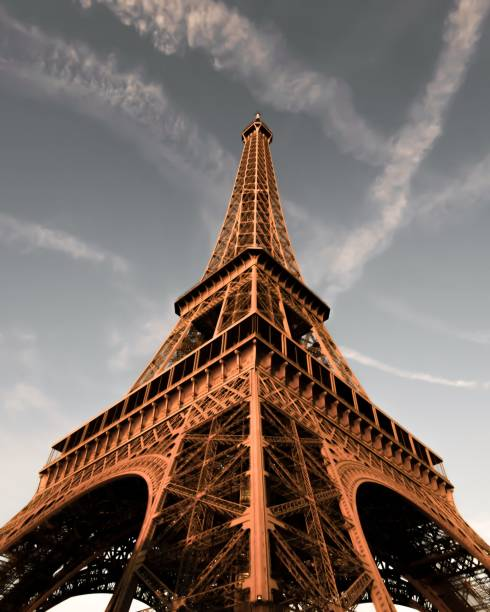 Beautiful Blue Sky Behind the Eiffel Tower in Paris, France Beautiful Blue Sky Behind the Eiffel Tower in Paris, France musee du louvre stock pictures, royalty-free photos & images
