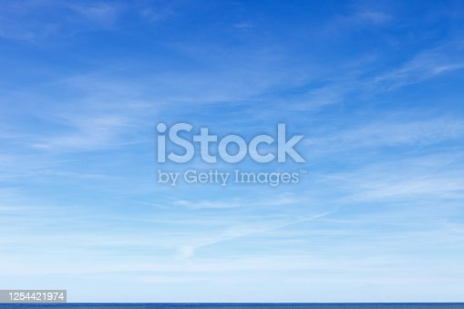 istock Beautiful blue sky with cirrus clouds over the sea. Skyline. 1254421974