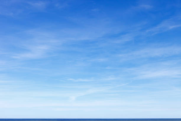 Beautiful blue sky with cirrus clouds over the sea. Skyline. stock photo