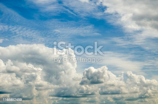 istock beautiful blue sky with cumin fluffy clouds 1165852459