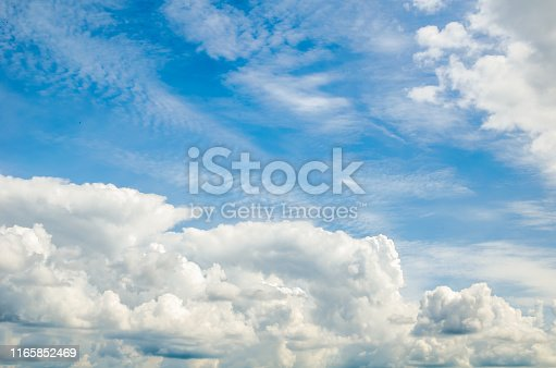 istock beautiful blue sky with cumin fluffy clouds 1165852469