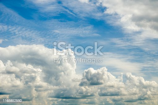 istock beautiful blue sky with cumin fluffy clouds 1165852550