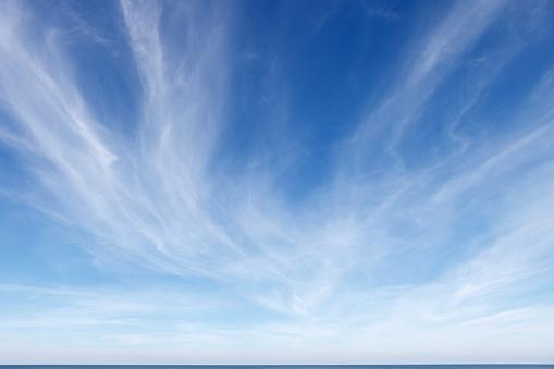 Majestic sun and clouds on blue sky