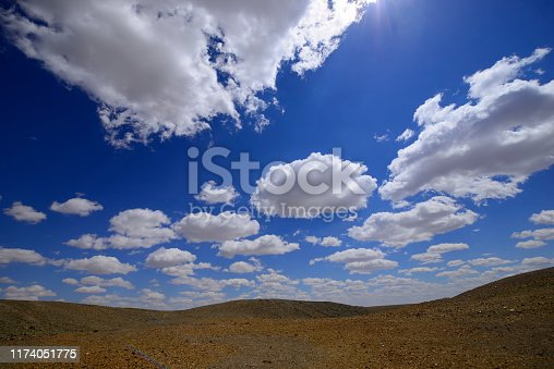 Beautiful blue sky with white clouds background.