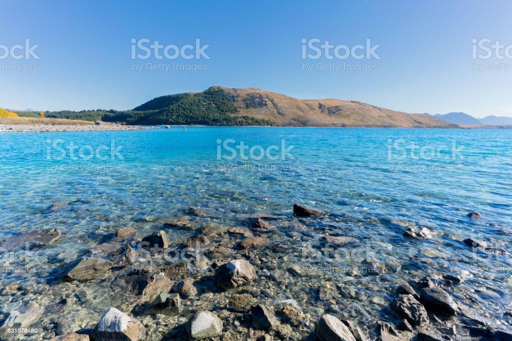 Beautiful blue water of Lake Tekapo on Sunday morning in Autumn , Mackenzie District Council , Canterbury, South Island of New Zealand stock photo