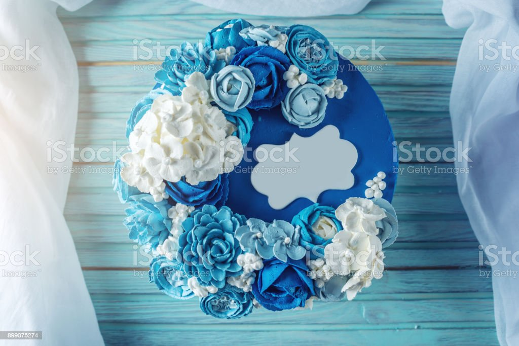 Beautiful blue wedding cake decorated with white flowers of cream. Concept of Holiday desserts for a birthday stock photo