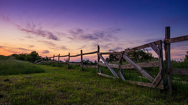 Beautiful blue-colored landscape, old wooden fence in the foreground stock photo