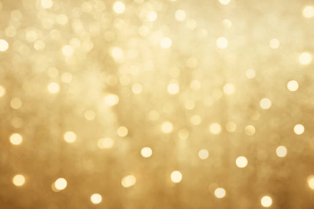 beautiful blurred golden bokeh background - glamour stock pictures, royalty-free photos & images
