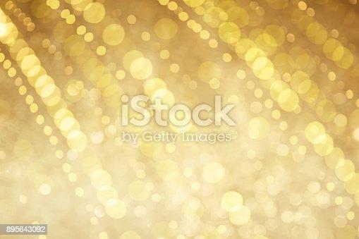 istock Beautiful blurred golden bokeh background 895643092