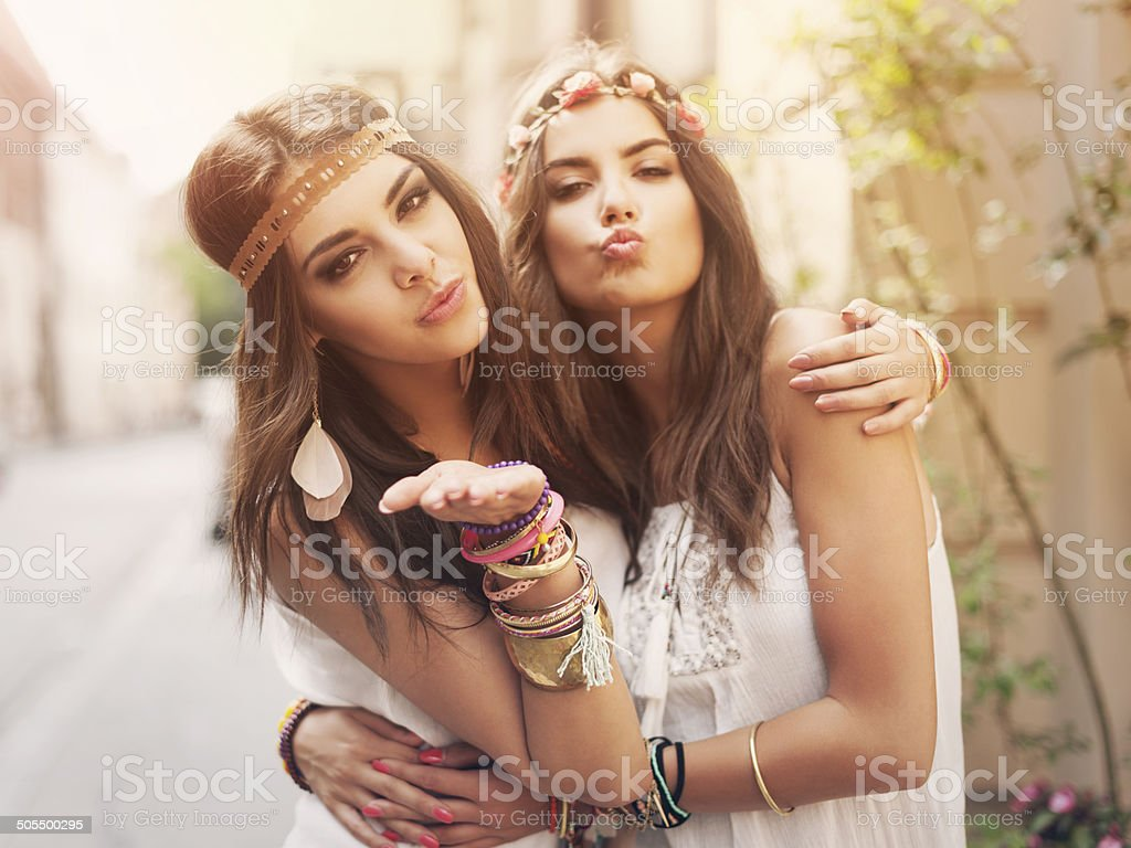 Beautiful boho girl blowing a kisses stock photo