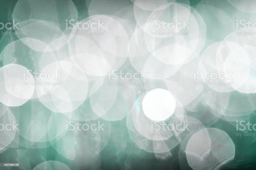 Beautiful bokeh focus lens effect cyan green abstract background stock photo