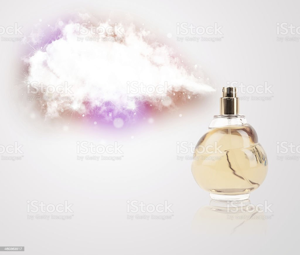 beautiful bottle spraying colorful cloud royalty-free stock photo