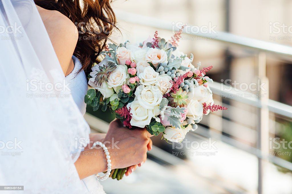 beautiful bouquet in hands of the bride stock photo