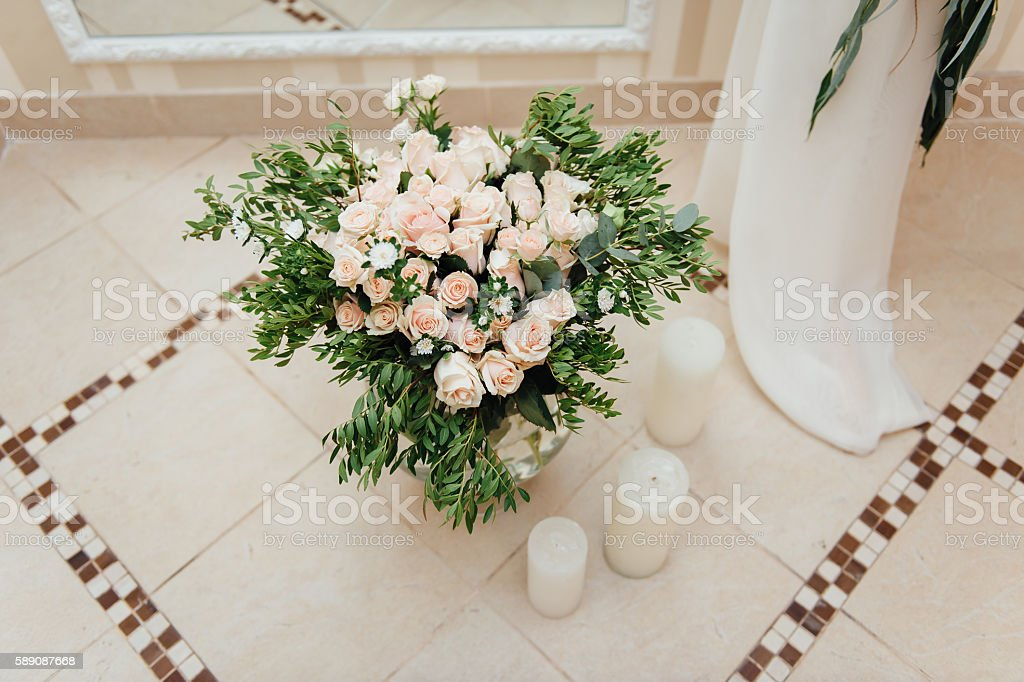 Beautiful bouquet of bright flowers in basket stock photo