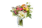 istock Beautiful bouquet of bright flowers in vase isolated white 511674764