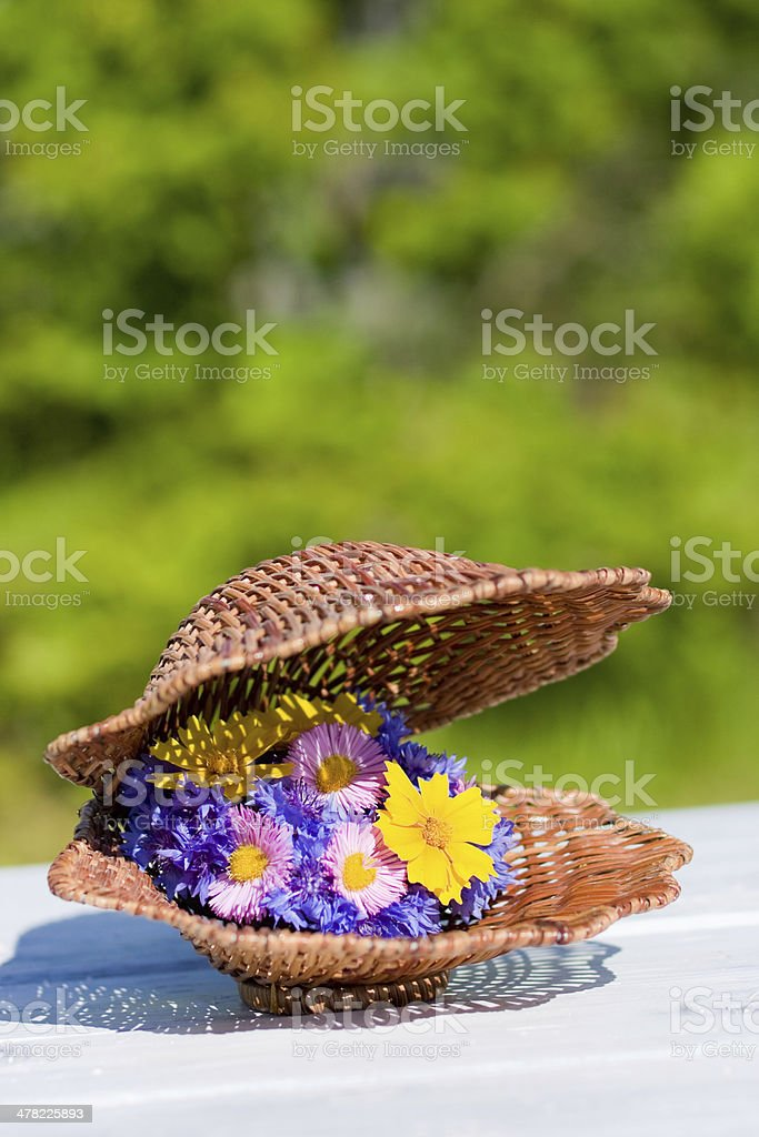 beautiful bouquet of bright wildflowers in wicker shell royalty-free stock photo