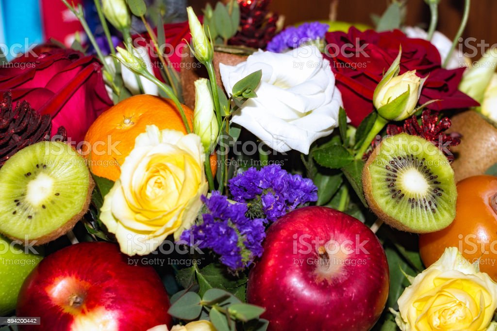 Beautiful Bouquet of flowers and fruit stock photo