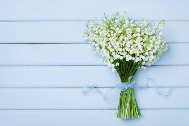 beautiful bouquet of flowers lily of the valley. flat lay. - flower bouquet blue and white bildbanksfoton och bilder