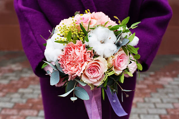 beautiful bouquet of flowers with cotton in female hands - immagini mimosa 8 marzo foto e immagini stock