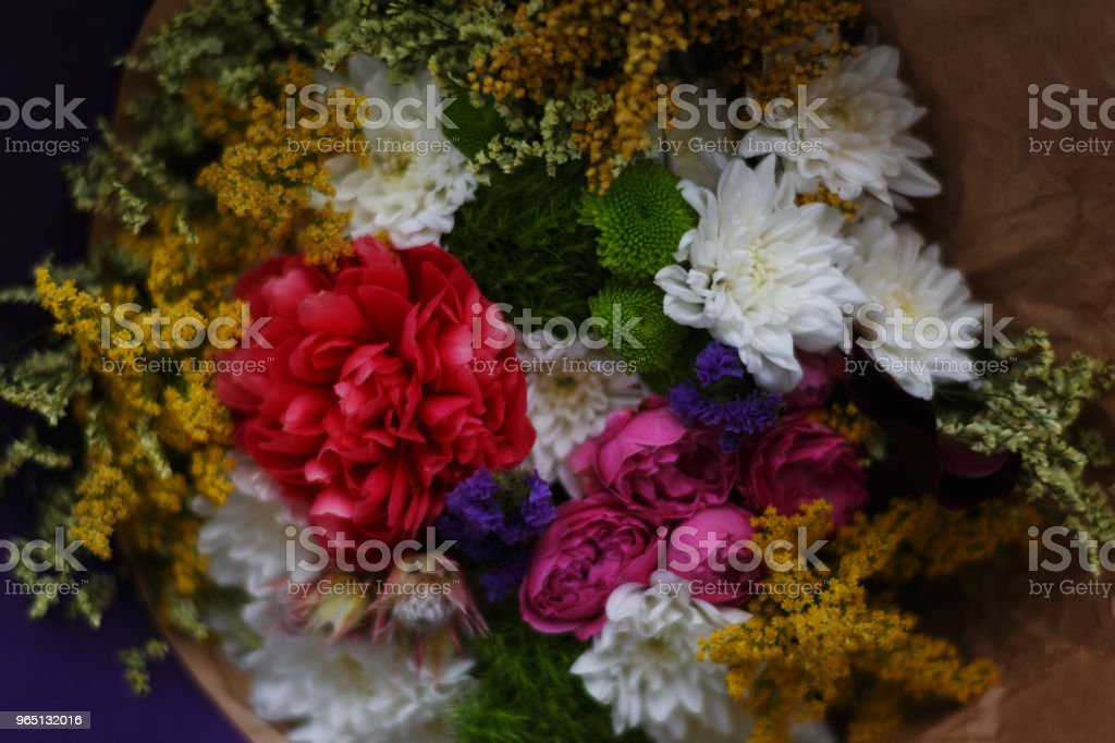 A beautiful bouquet of fresh summer flowers wrapped in decorative paper. Top view of flowers royalty-free stock photo