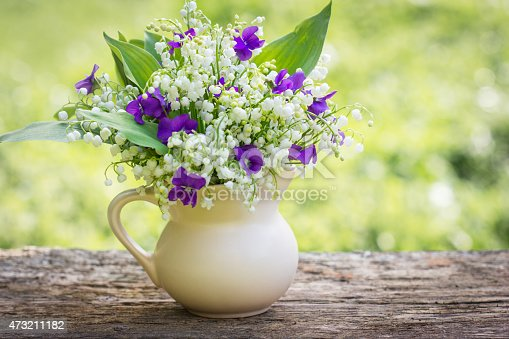 Beautiful Bouquet Of Lilies Of The Valley And Violets On