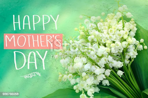 istock Beautiful bouquet of lilies of the valley. Mother's day greeting concept 936766058
