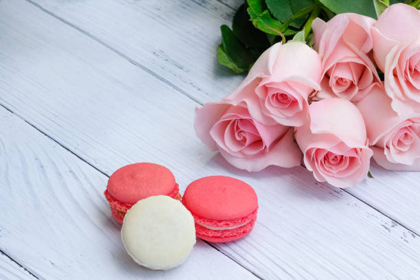 Beautiful bouquet of soft pink roses and pieces of macaroon picture id1092421826?b=1&k=6&m=1092421826&s=612x612&w=0&h=f8u ne3ahgmuvlogb7ocrcl7 hocp181ry8x3x  jcs=