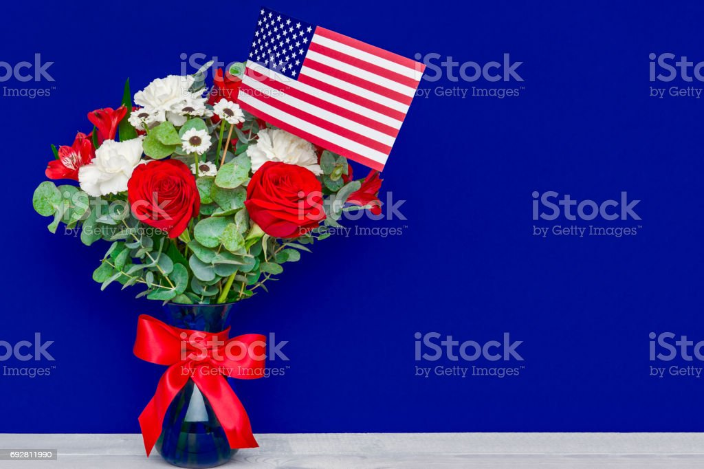 Beautiful bouquet with american flag on blue background stock photo