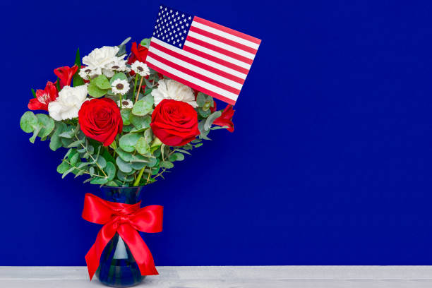 beautiful bouquet with american flag on blue background - fourth of july стоковые фото и изображения