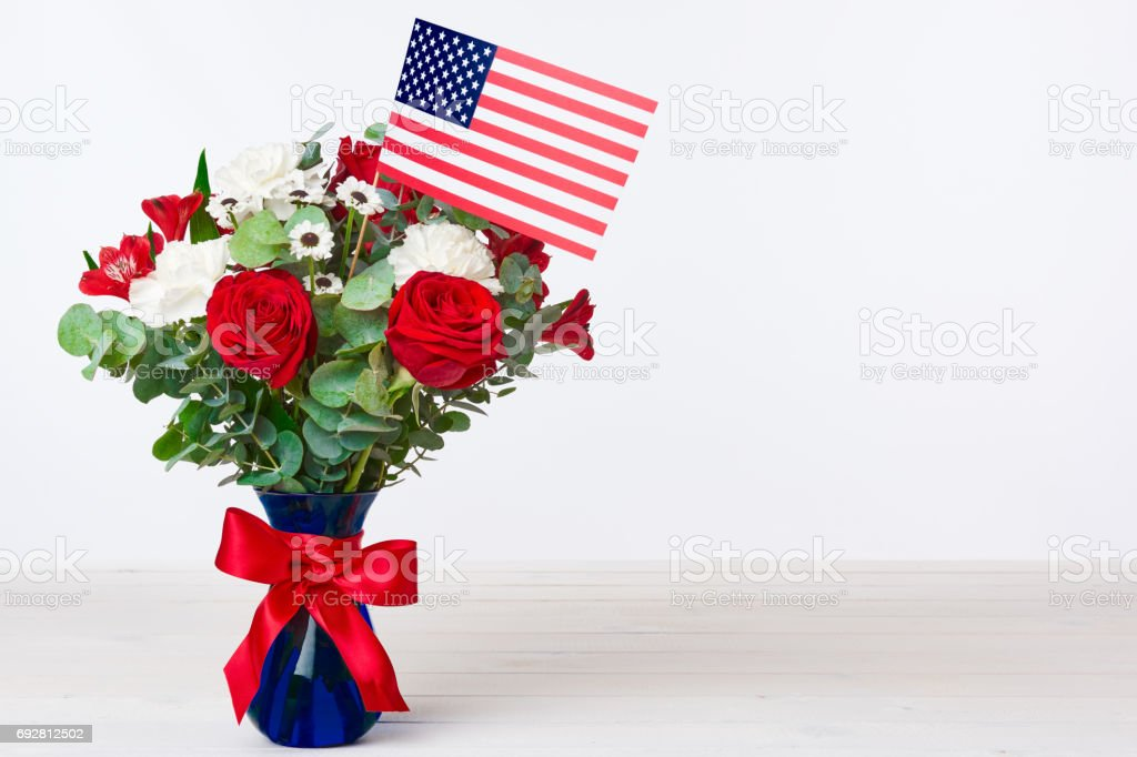 Beautiful bouquet with american flag on white background stock photo