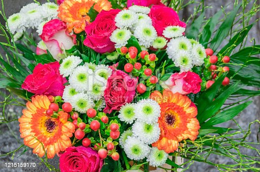 Beautiful bouquet with fresh pink roses, gerberas, daisies, hypericum with dew drops in flower shop outdoors. Can be used as a greeting card with Happy Valentine's Day, Wedding, Mother's Day, Birthday