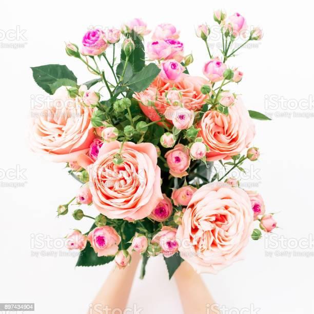Beautiful bouquet with pink roses in hands on white background flat picture id897434904?b=1&k=6&m=897434904&s=612x612&h=xskau9g29n4qulr16peqk1bo izdb8mpoo3yjofdoiq=