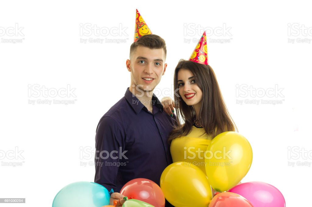 beautiful boy and girl celebrating birthday with balloons in hands stock photo