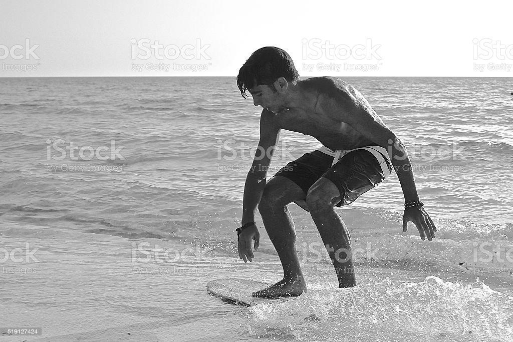 Beautiful boy at the beach stock photo