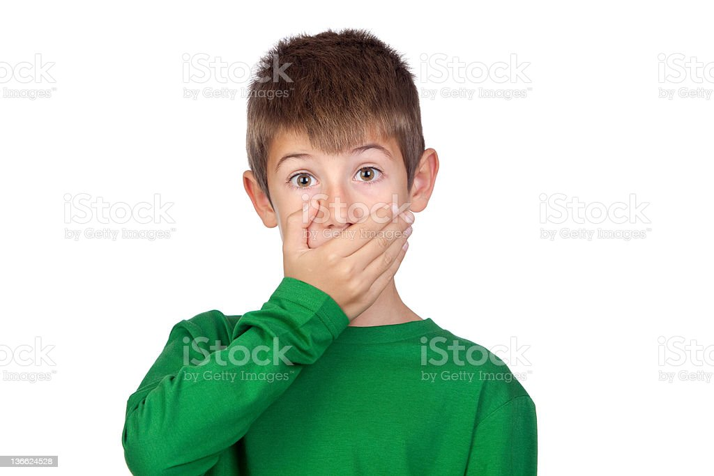 Beautiful boy covering his mouth stock photo