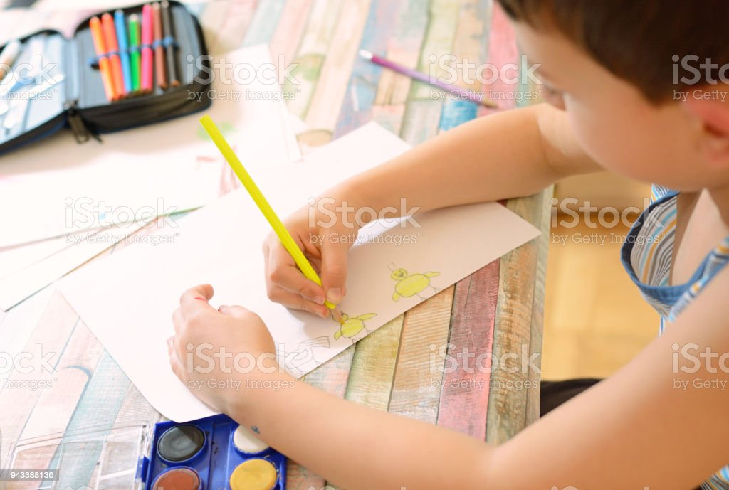 Beautiful Boy Drawing With Water Color And Colorful Crayons Royalty Free Stock Photo