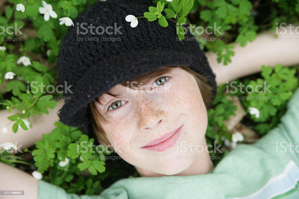 Beautiful Boy Resting in Wildflowers- Anemone royalty-free stock photo